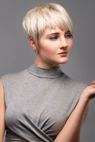 Short Straight Pixie Hairstyle With Asymmetrical Bangs #pixiecut #haircuts #shortpixie #blondehair