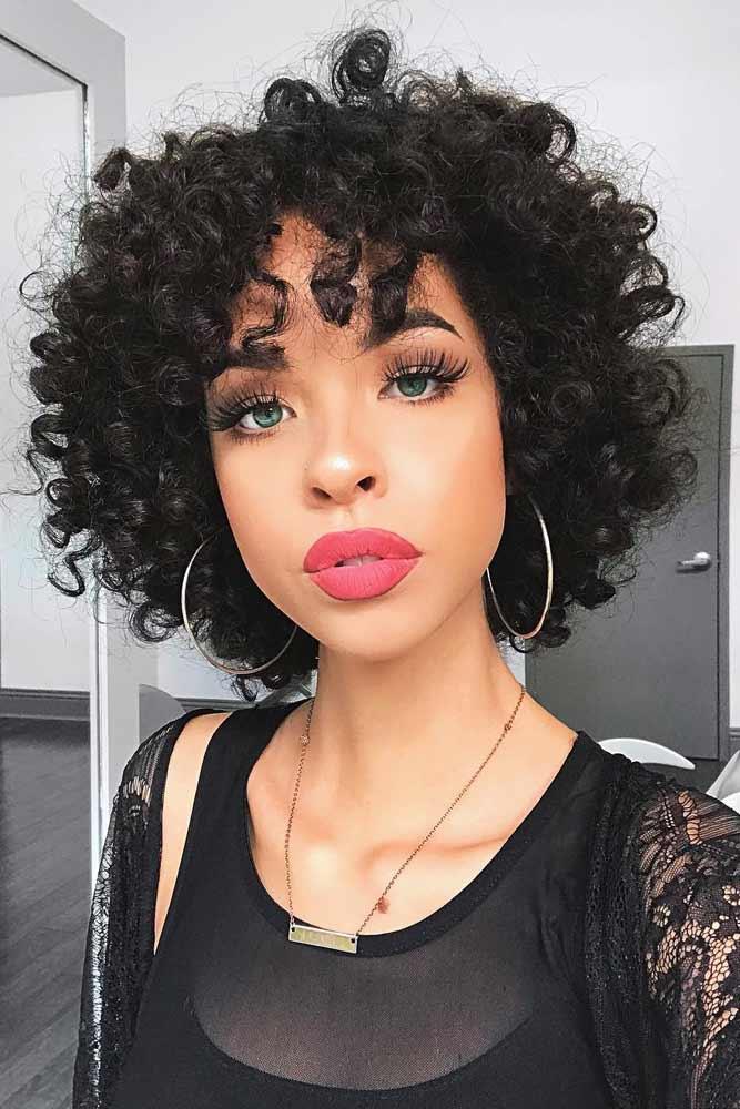 Curly Layered Bob With Bangs #shortcurlyhairstyles #curlyhairstyles #shorthairstyles #hairstyles #bobhairstyles