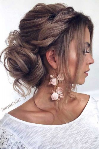 Messy Updo And Side Swept Bangs #hairstyleswithbangs #hairstyles #bangs #bobhairstyles #updohairstyles