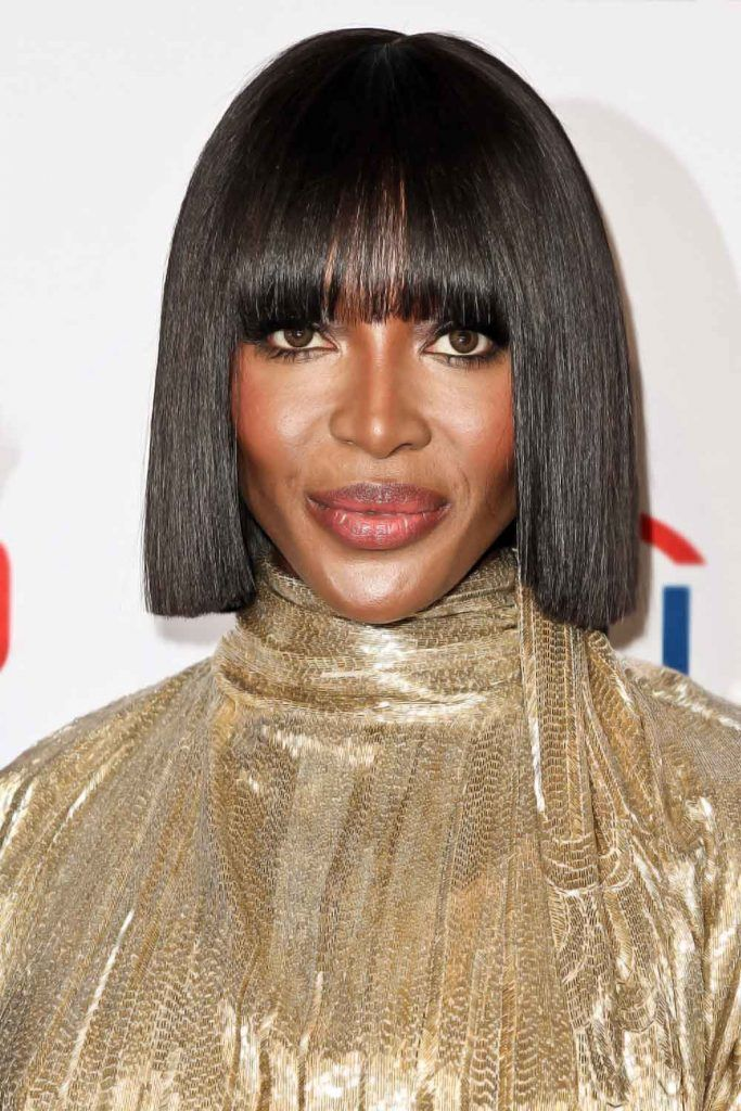 Naomi Campbell: Sleek Blunt Bob With Thick Bangs #hairstylesforwomenover50