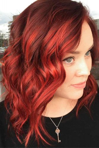 Voluminous Red Curls #mediumhaircut #redhair #wavyhair