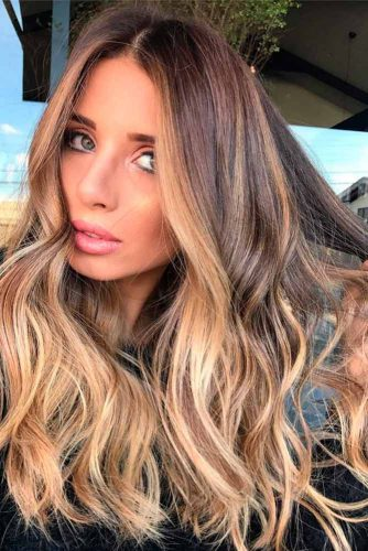 haircuts for medium wavy hair 37 trendy hairstyles for medium length hair 2561 | beach wavy hairstyles for medium length hair blonde ombre layered haircut 334x500
