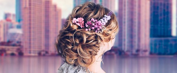 Charming Bridesmaids Hairstyles Completed With Flowers