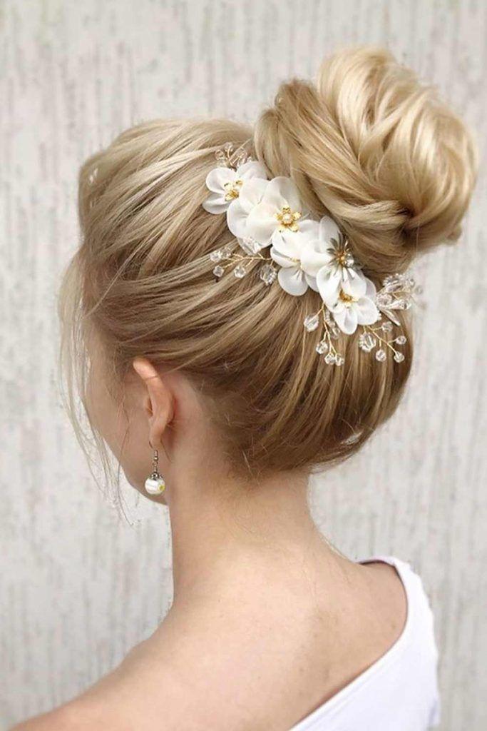 High Bun With Floral Accessories #highbun #formalhairstyles