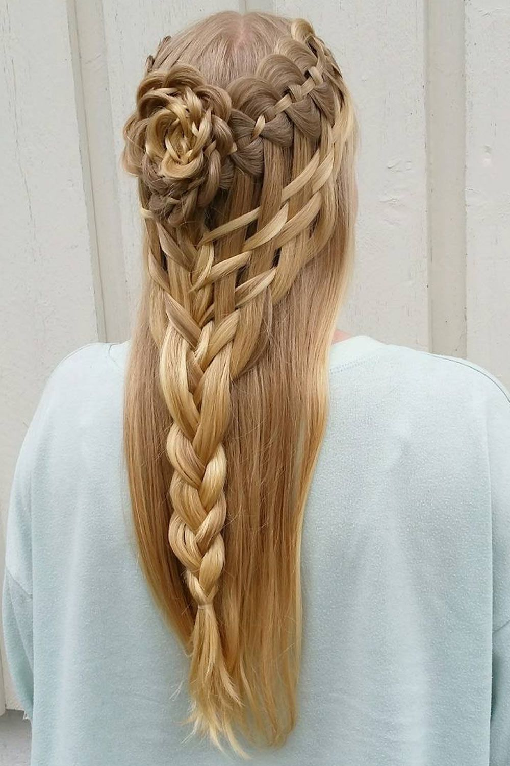 Hairstyle With Ladder Braid And Braided Flower