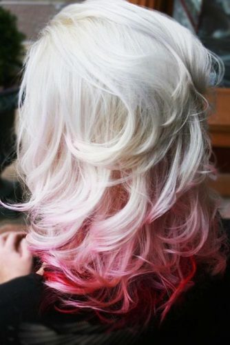Bombshell Blonde with Bright Red Accents
