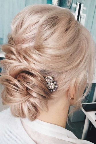 Messy and Trendy Updo with Flowers picture1