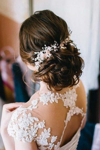 Messy and Trendy Updo with Flowers picture3
