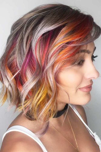 Colored Hairstyle With Flirty Side Swept Bangs #mediumhairstyles #hairstyles #mediumlengthhairstyles #bangs