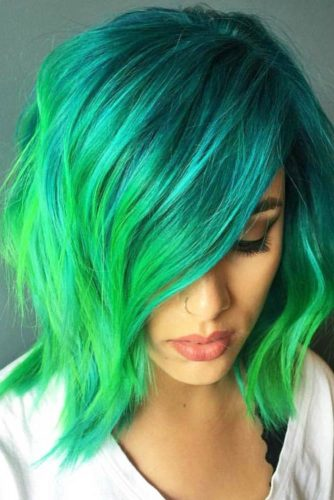 Green Hairstyle With Flirty Side Swept Bangs #mediumhairstyles #hairstyles #mediumlengthhairstyles #bangs