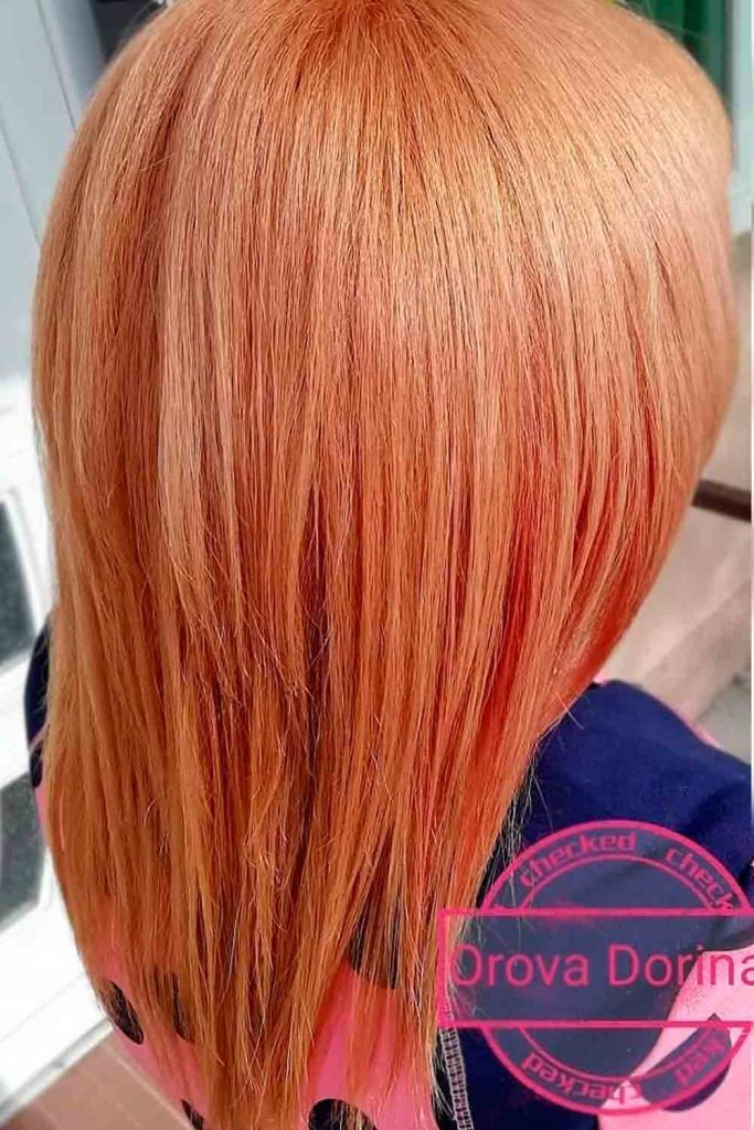 Medium straight hair with cool orange color