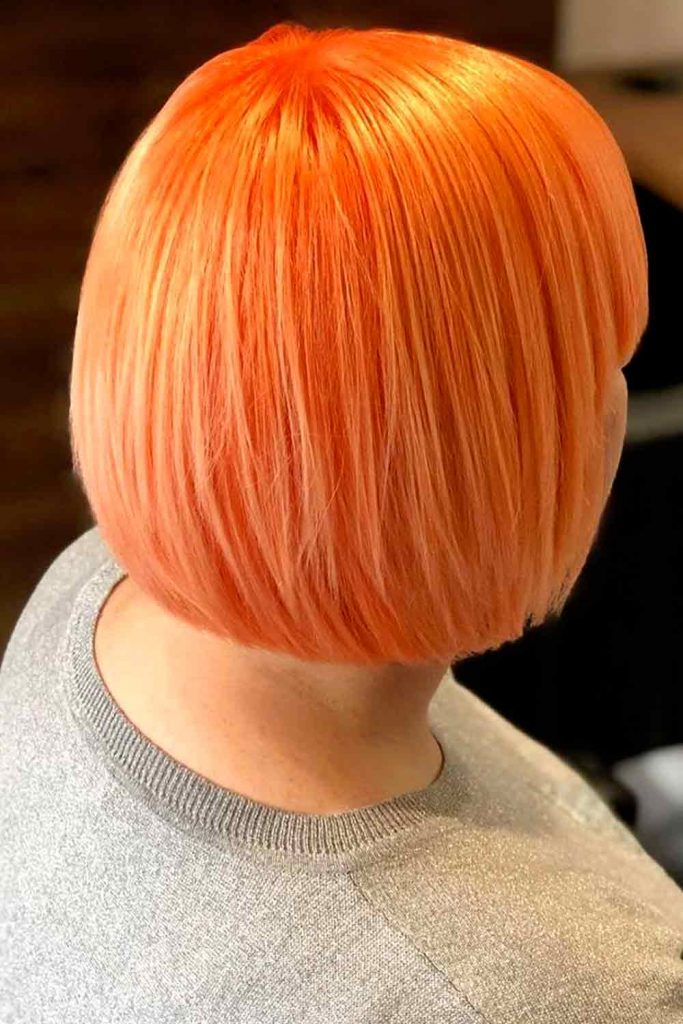 Short haircut with bright orange color looks great