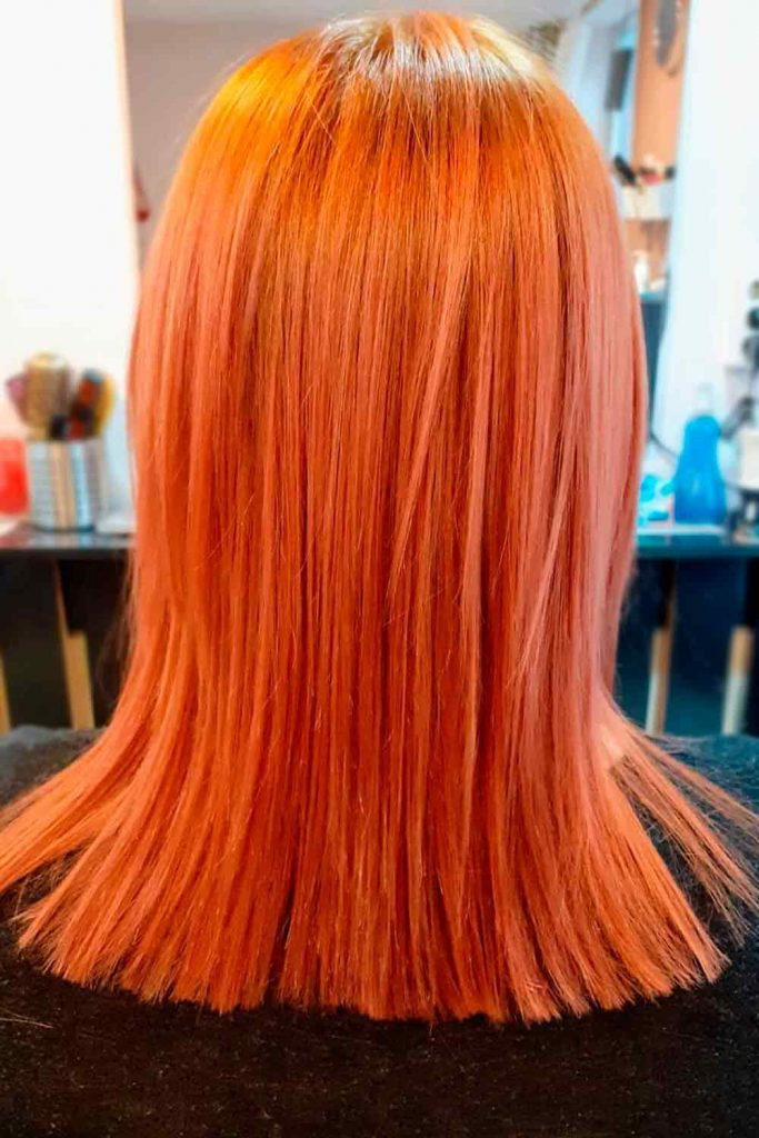 Cool blorange color on straight hair