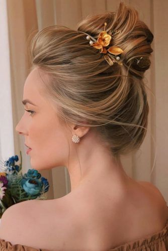 Tender High Bun With Flowers #homecominghairstyles