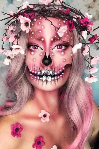 Geisha Skull With Accessorized Hairstyle #halloweenhairstyles #halloween #hairstyles #skullmakeup #longhair