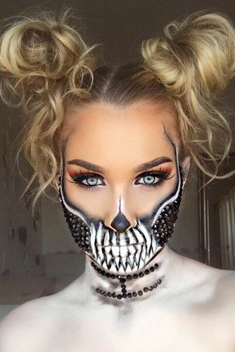 Skull Makeup With Messy Space Buns #halloweenhairstyles #halloween #hairstyles #skullmakeup #longhair