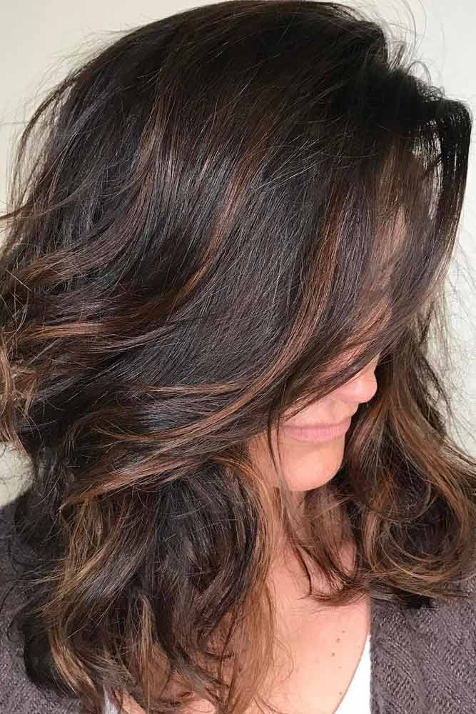 Medium Layered Hair with Side Bang and Highlights