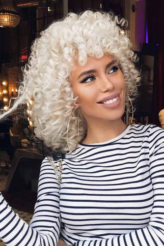 Trendy Curly Platinum Blonde Bob Hairstyle With Bang #platinumblonde #bleachedhair #curlyhair #curlybob #bobwithbangs