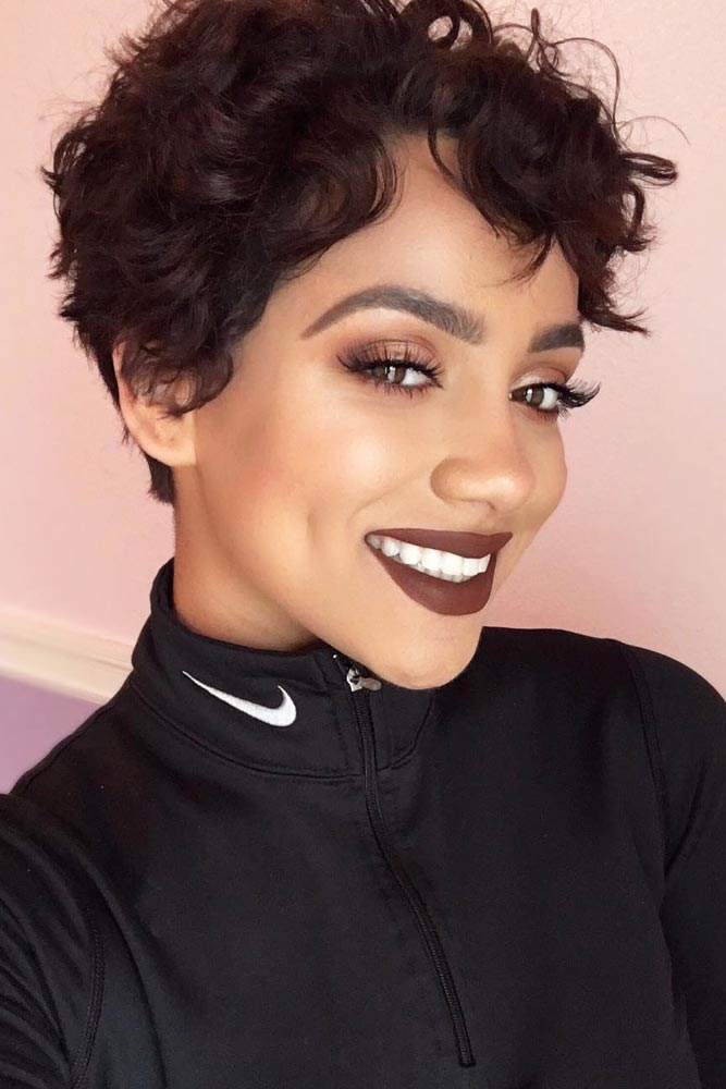 Sassy Curly Pixie Cut With Sweeping Bangs #curlypixiecut #pixiecut #haircuts #hairtypes #shorthair