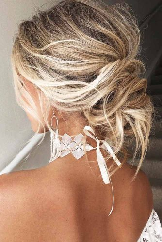 Highlighted Low Messy Bun Hairstyle #blondehair #bun #highlights
