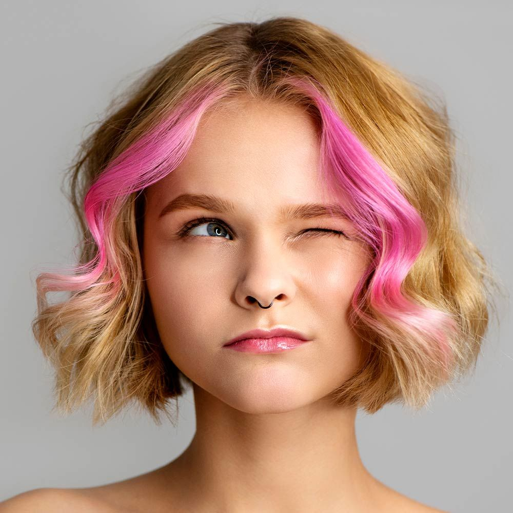 Curly Blonde Bob Haircut With Pink Highlights
