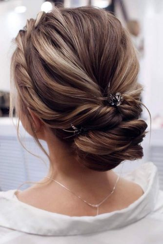 Accessorized Low Chignon Bun With Twists #chignonbun #hairstyles #bunhairstyles