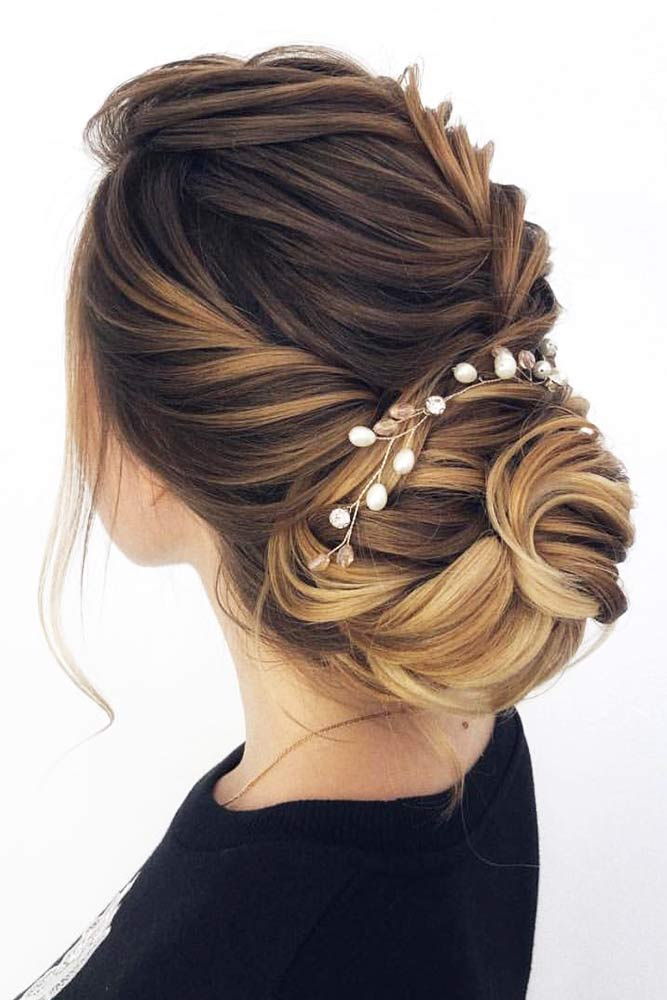 Accessorized Chignon Bun With Twists #chignonbun #hairstyles #bunhairstyles