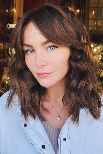 Wavy Bob With Center-Parted Bangs Medium Haircuts For Women #mediumhair