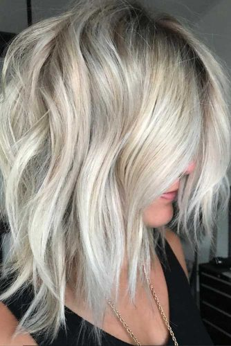 Middle Part Medium Length Haircuts For A Heart Face #mediumlengthhaircuts #mediumhair #haircuts #longbob #blondehair