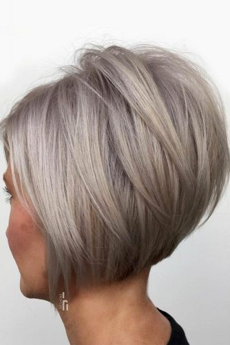 Silver Inverted Bob With Overlapping Long Layers #shortbob #shortbobhairstyles #hairstyles #bobhairstyles #silverhair
