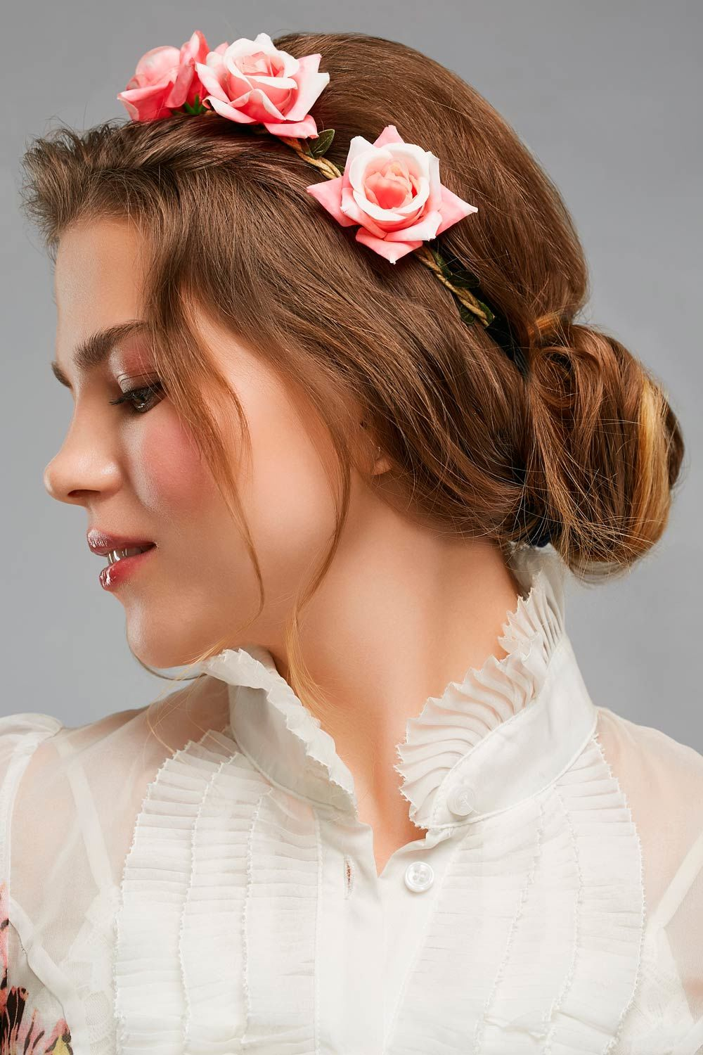 Accessorized With Flower Hairstyle With Bun
