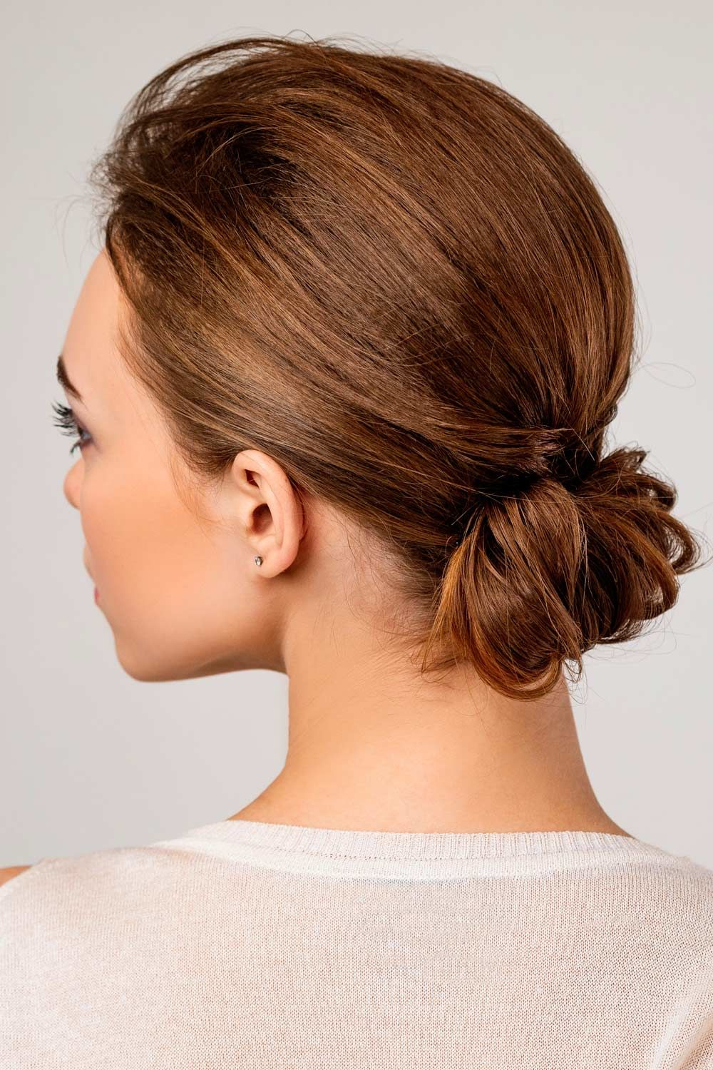 Crimped Hair Putting Into Low Bun