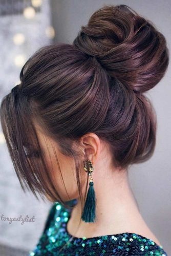High Bun And Side Bangs