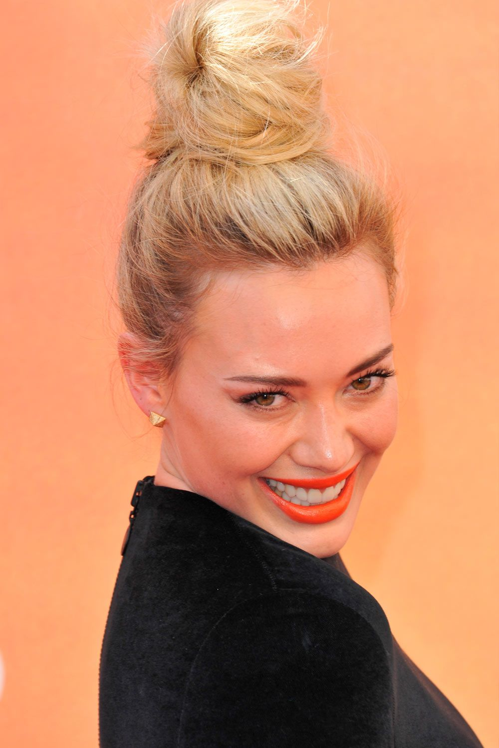 Messy Blonde Hairstyle With Top Bun
