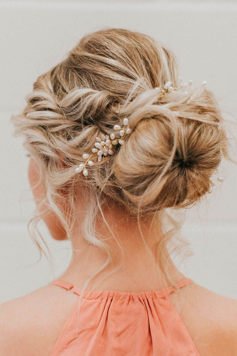 Messy And Accessorized Blonde Updo Hairstyle