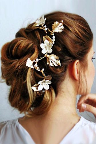 Gentle Swept Back Hairstyle With Floral Accessory #updo #lowbun #bridalaccessory