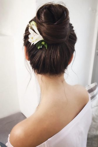 High Bun With Flower #bun #weddinghairstyle