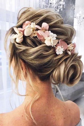 Twisted Low Bun With Flowers #weddinghair #updo