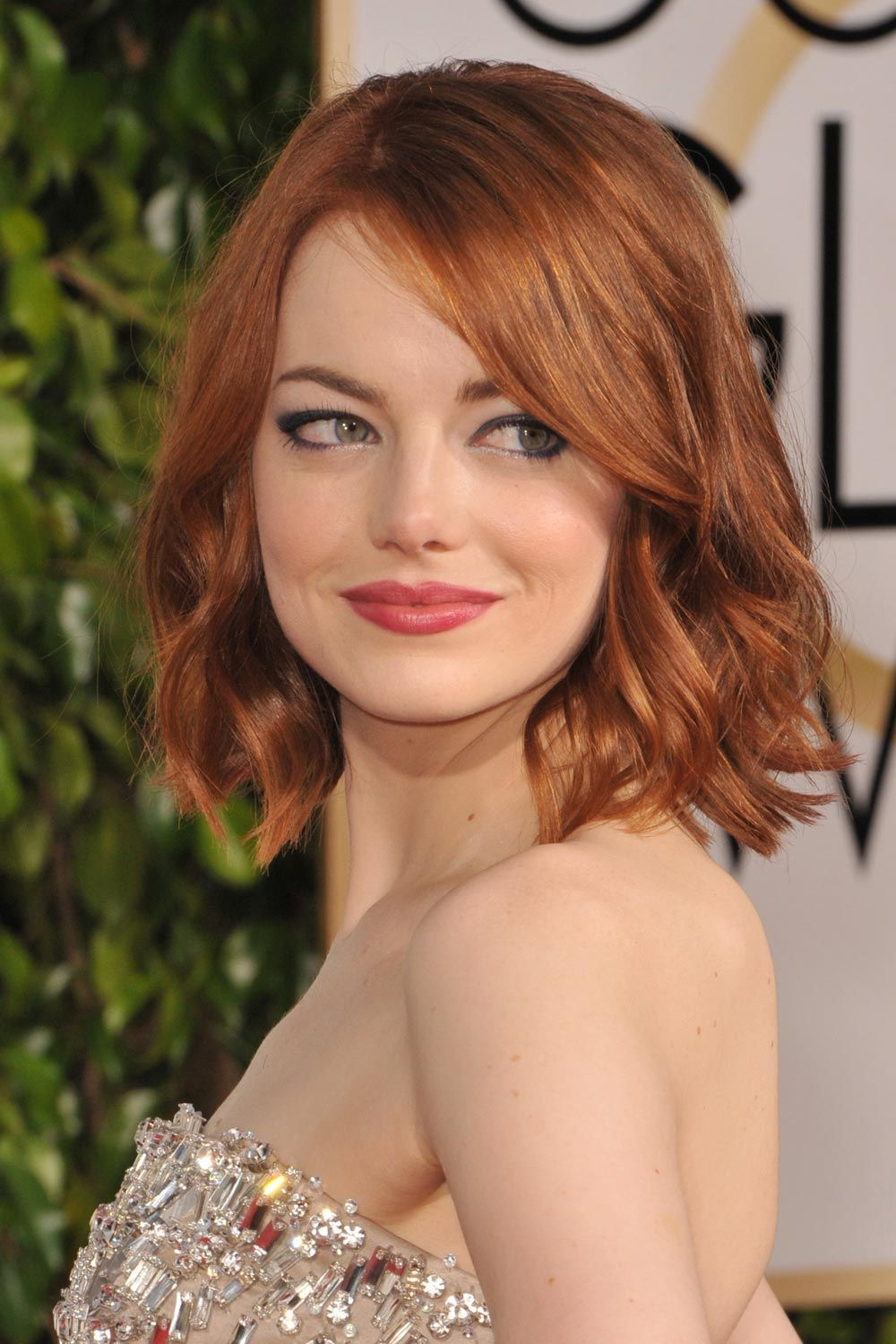 Emma Stone With Red Wavy Bob And Side Bangs
