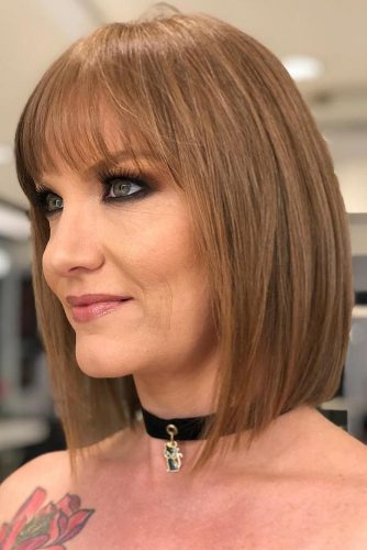 Light Auburn Blunt Bob With Thin Bangs #bob #sleekhair #bangs