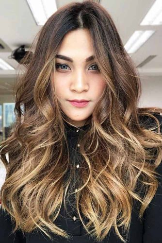 haircut for diamond shaped face 24 flattering haircuts and hairstyles for shape 5056 | charming hairstyles for diamond face shape messy long wavy 334x500