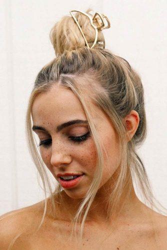 High Messy Bun With Stylish Accessory #hairbun #shorthair #bunhairstyles #hairstyles #blondehair