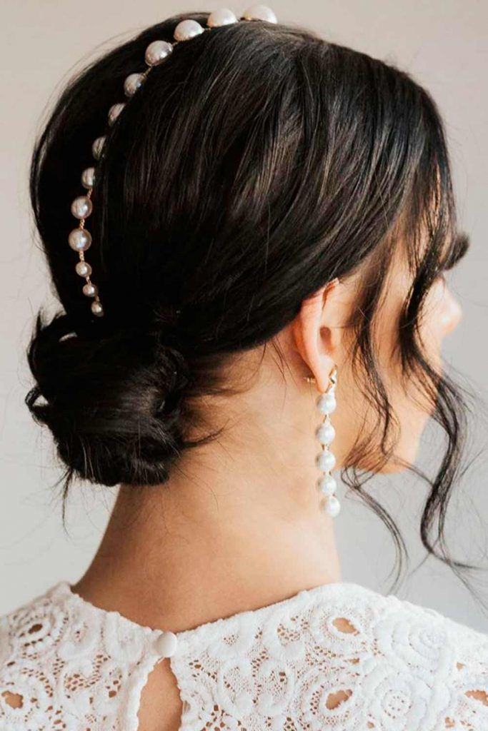Accessorized With Pearls Messy Low Bun