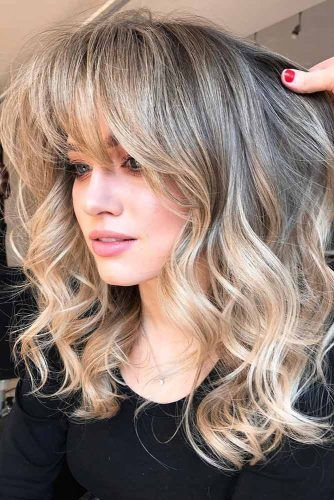 Wavy Shag With Long Straight Bangs #shaghairstyles #shaghaircuts #mediumlength #hairstyles