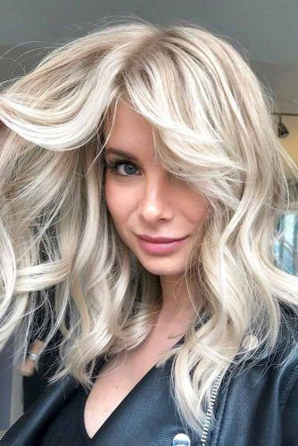 Blonde Shag With Side Swept Bangs #shaghairstyles #shaghaircuts #mediumlength #hairstyles