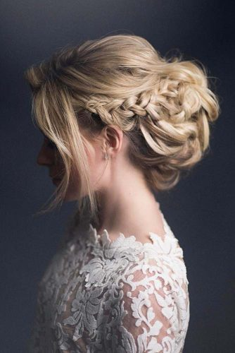 A Voluminous Updo With Braided Elements #weddingupdo #weddinghair #braidedupdo #longhairstyles