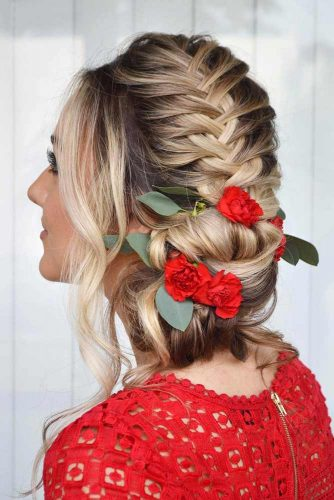 A Fishtail French Braid With Bright Flowers #weddingupdos #weddinghair #fishtailbraid #flowers