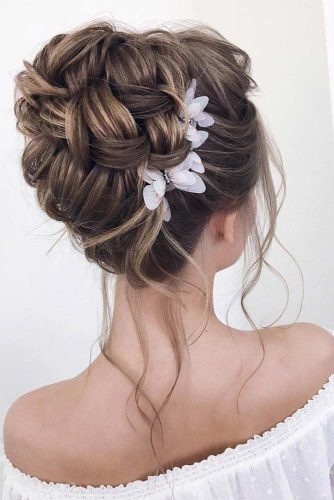 An Accessorized Big Messy Bun #weddingupdo #weddinghair #messyupdo #highbun #hairaccessories