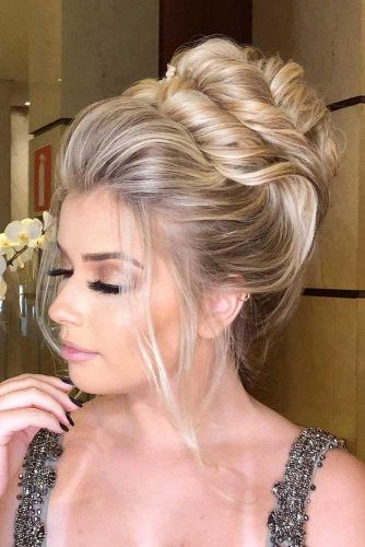 Twisted High Updo #weddingupdo #weddinghair #hairstyles #updohairstyles