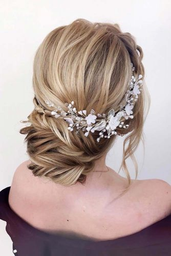 A Low Braided Updo #weddinghair #weddingupdo #hairaccessories #braidedupdo